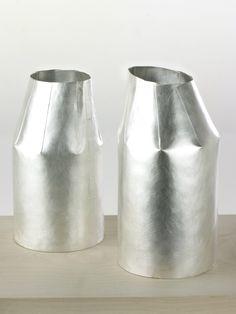 Silver milk jugs by designer maker Maike Dahl.