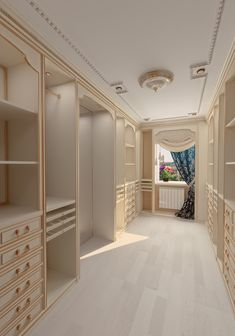 Beautiful, deep walk in closet in light wood and gold trim and plenty of organization.