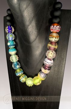 """Lampworked glass """"Hula"""" necklace. 18mm diameter pleated, dotted & handmade murini adorned etched glass bead necklace by Renee Wiggins. 1/2015"""