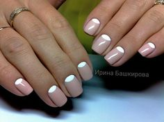 This nail design embodies classical motifs and comfortable minimalism. Universal combination of white and cream colors creates an atmosphere of tenderness