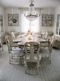 Various periods of antiques, all styles combine to present this beautiful and ecletic dining room...