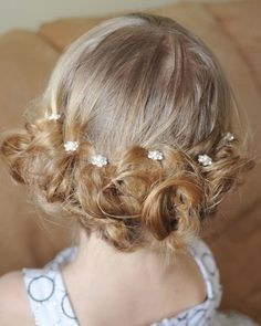 flower girl hairstyle low bun