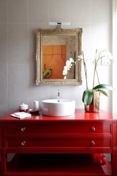 Use clean porcelain tile to complement a bold vanity. (Try our Code or Magma series tile to get the look!)