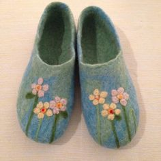 My first ever attempt at wet felt slippers! Decoration is needle felt.