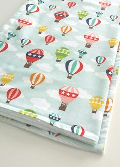 Hey, I found this really awesome Etsy listing at https://www.etsy.com/listing/225657295/baby-blanket-in-blue-hot-air-balloons