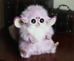 Adorable doll by Santani