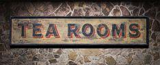 """This near-replica was inspired by a weathered sign above an old shuttered tea room in London's Camden borough. New tenants recently painted over the entire facade, including the sign. Just over 5-feet wide at 64"""" x 13.25."""""""