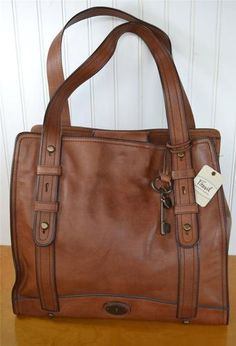 Fossil Tote....you can NEVER go wrong with a solid leather bag! Like, Comment, Repin !!