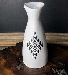 This white glazed ceramic vase/pitcher features original black Geometric decals.