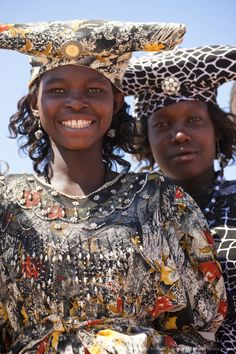Herero women, Kaokoland, Namibia, Africa  Getting excited. Also I want to see my friend. Meow.