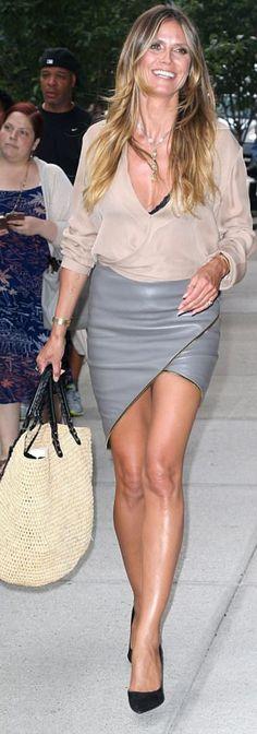 Who made Heidi Klum's black suede pumps, gray leather skirt, and straw handbag?