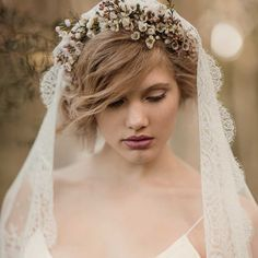 MANTILLA VEIL WITH FLOWER CROWN 36 Stunning Wedding Veils That Will Leave You Speechless  - Cosmopolitan.com