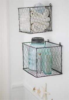Bring classic vintage charm to any room in your farmhouse with our Wire Basket Box Set. There's nothing quite as rustic as chicken wire, which farmers have been up-cycling for decades. Emblematic of rural self-reliance and practicality, these boxes will find any number of decorative and organizational uses in your home, whether fastened securely to a wall or resting on any surface. Distressed metal finish. Set of two