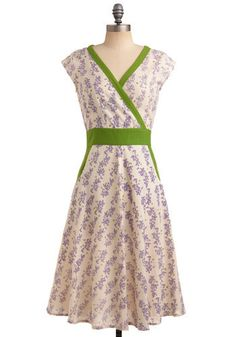 I like the vivid green contrast trim against the pastel purple-and-cream main fabric of this dress.