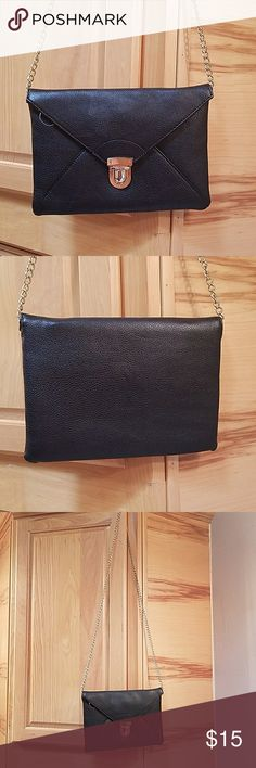 """Forever 21 black clutch Forever 21 black clutch  Has some marks,  see pics.. mostly in hardware opening  Made of Polyurethane   Used condition  9 x 6.5 x .5,   44"""" chain Forever 21 Bags Clutches & Wristlets"""