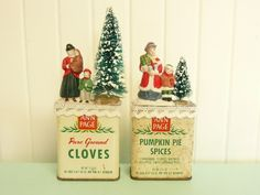 Here we have an adorable holiday decor set: Two Ann Page vintage spice tins (Pumpkin Pie Spice and Pure Ground Cloves) re-purposed with crochet lace edgings, vintage bottle trees, and vintage hand painted porcelain figurines, with a sprinkling of artificial snow flakes added to the top. This listing is for both for one price. Each measures 2 3/4 tall by 2 1/4 long by 1 1/8 deep. With the top adorned, the Pumpkin Pie Spice tin is about 5 tall and the Cloves tin is 6 12/4 t...