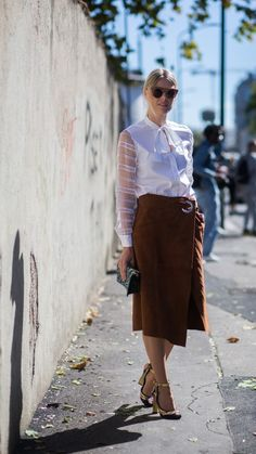 We've captured the best street style from cities across the world to inspire your office wear. This white pussybow blouse with sheer sleeves looks great paired with a long brown skirt and yellow heels. Be inspired by more such looks at www.redonline.co.uk.