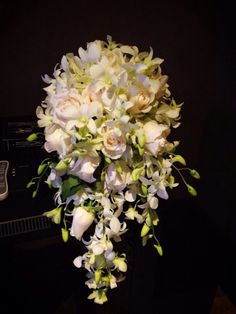 Roses and orchids wedding bouquet