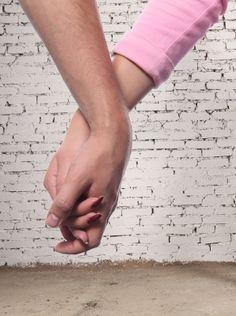 pareja de la mano
