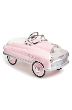 What little girl wouldn't want this darling pedal car with a pink paint job and retro vibe?