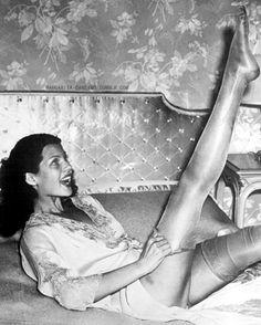 SILK STOCKINGS - Rita Hayworth modeling stocking - 1938.