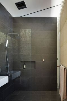 Wet Room Design Ideas If you are thinking about ways to spruce up your interior then you should look into wet rooms. What is a wet room you ask? Simple: its a new approach to bathroom design in which there is no tub shower screen or tray. Small Grey Bathrooms, Gray And White Bathroom, Modern Bathroom, Bathroom Black, Dark Tiled Bathroom, Modern Shower, Small Wet Room, Wet Room Bathroom, Bathroom Ideas