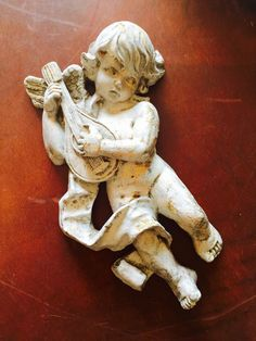 A personal favorite from my Etsy shop https://www.etsy.com/listing/234943561/shabby-chic-angel-wall-hanging-cherub