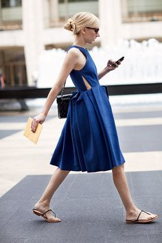 A bold, bright blue dress like this doesn't need much in the accessory department to tie the look together. Barely-there footwear and a black quilted handbag with fresh, polished nails make a put-together look.