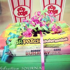 """Wedding gift for my friend! Two bags of popcorn, popcorn bowls, the movie """"Run Away Bride,"""" Sour Patch Kids and a Celebration Journal to write all about wedding planning! :) Makes for the perfect """"Date Night"""" gift!"""