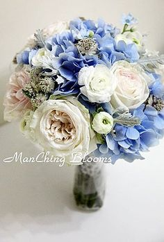 Bridesmaid bouquet ideas.  Light Blue Wedding Flowers | Light Blue & White Bouquet