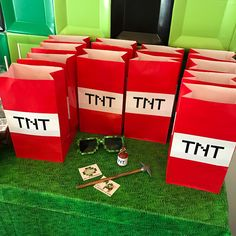 Party favors and DIY TNT favor bags for a Minecraft themed birthday party. Click to get all the details for food, party favors, signs, and activities (including free printables) on FabEveryday.com.