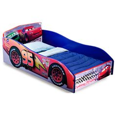 """Features:  -""""Lightning Mcqueen"""" race car design.  -Authentic Pixar's Cars decal.  -Built with a strong and sturdy wooden frame.  -Meets all JPMA safety requirements.  -Disney Pixar Cars collection.  -"""