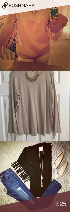 Awesome long sleeve tan fringe shirt! Tan, long sleeve shirt with fringe down the arm! Bought from a boutique and never worn! Tops Tees - Long Sleeve