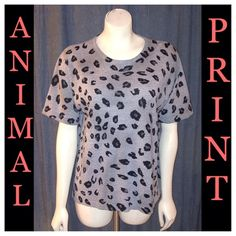 """NWOT Gray Leopard/Cheetah Short Sleeve Sweater LRG Size Large, Gray Leopard/Cheetah Print Short Sleeve Sweater.   New without tags, never worn!  By Cathy Daniels, Made of 100% Acrylic.  Light Gray w/Black & Dark Gray Animal Print Spots (Cheetah/Leopard).    Measurements were taken with top laying flat and are approx: •20 1/2"""" across the chest measured under the armpits (approx 41"""" bust) •22"""" wide across the bottom, side seam to side seam •25"""" long, measured down the back center Cathy Daniels…"""