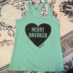 XOXO Super Cute Tank NWT Light teal tank with black sparkle heart breaker logo. Slight staining as shone in 2nd pic. Two small holes from tag. Still excellent condition. FYI XOXO runs a bit small. Perfect for summer. XOXO Tops Tank Tops
