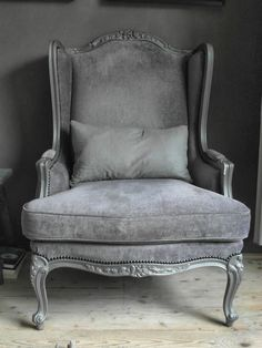 This is the exact color of grey I want for the two matching chairs. I love the paint color on the wood, as well.