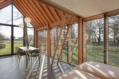Znalezione obrazy dla zapytania przeszklony dom z drewna