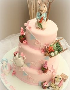 Peter Rabbit cake for girl. The Peter rabbit is kind of scary but I love the banner running across the cake