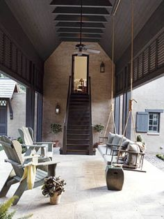 A Surprising Sitting Area: In a soaring breezeway, a dramatic staircase leads to a guest suite over the garage.