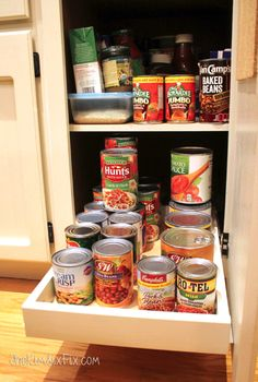 Organize Your Pantry with DIY Slide-Out Cabinet Shelvesvia TheKimSixFix.com