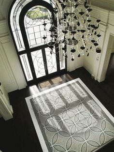 Terra Verre - entrances/foyers - dark hardwood floors, hardwood floors, espresso hardwood floors, marble mosaic tiled floors