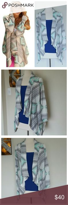 """New Aztec Knitwear Open Cardigan NWOT in package. Perfect for fall/winter. Lightweight, soft open cardigan with irregular lengths and loosely knitted. White base color with sea green and gray. Fun tribal, aztec style print. Approximate measurements: Length: 25-26"""", Sleeves: 23-24"""", Chest 34-39"""" (Range for sizes Small to Large). Sweaters Cardigans"""