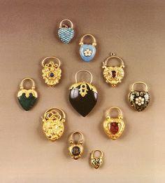 Gold, enamel, and gem set hear shaped padlock clasp pendants, 1855