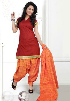 Be a #trendsetter where ever you go draping this Maroon-Orange Color Cotton Designer Patiala #SalwarKameez which is accompanied with a printed dupatta and bottom. The suit features a lace embellished border and yoke along with interesting prints.