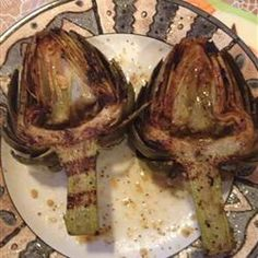 This recipe is supposed to taste like the artichokes I love from Houston's restaurant. Grilled Garlic Artichokes