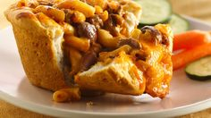 Looking for a delicious dinner? Then check out these cheesy pasta pies made with chili and Pillsbury® Grands!® biscuits - perfect if you love Italian cuisine.