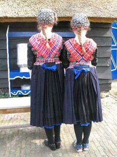 Europe | Portrait of two young girls wearing traditional clothes, Staphorst, Overijssel, The Netherlands