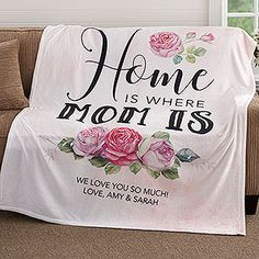 "This GORGEOUS Personalized Blanket is the perfect Mother's Day GIft idea! I love the ""Home is Where Mom is"" quote and the pretty flowers! You can pick a black or pink background and you can personalize it with any 2 lines at the bottom. Mom would LOVE this!"