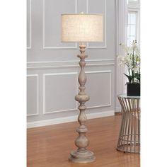 Latte Grande Floor Lamp | Overstock.com I'm thinking you could maybe DIY a lamp like this if you, I don't know, drilled a hole through some wooden finials and stacked them. Or something. Or string together a couple of thrift-store lamps with the hardware removed and the bases sawed off?