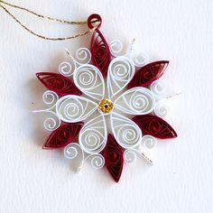 https://flic.kr/p/BxnN6e | 6 point small red and white quilled snowflake with gold glitter